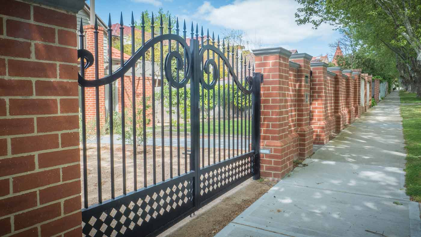 Brick Fence with Fancy Steelwork in Melbourne